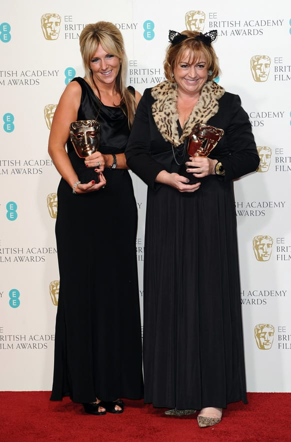Anna Lynch-Robinson, left, and Eve Stewart pose with the Production Design award for backstage at the BAFTA Film Awards at the Royal Opera House.