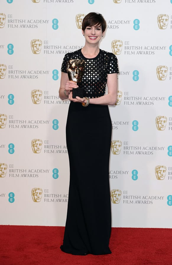 American actress Anne Hathaway poses backstage with the award for Supporting Actress for her role in