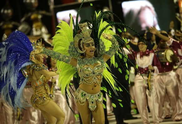 Performers from the Sao Clemente samba school parade during carnival celebrations at the Sambadrome in Rio de Janeiro, Brazil.