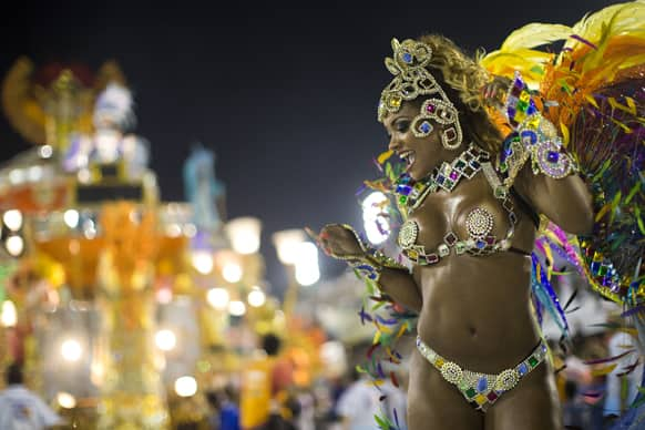 A performer from the Beija Flor samba school parades during carnival celebrations at the Sambadrome in Rio de Janeiro.