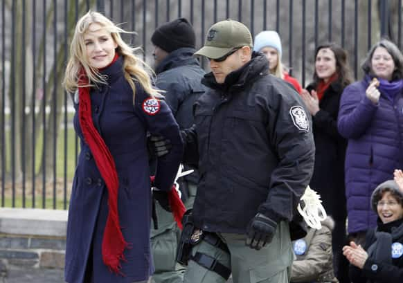 Actress Daryl Hannah is arrested outside the White House in Washington, as prominent environmental leaders tied themselves to the White House gate to protest the Keystone XL oil pipeline.
