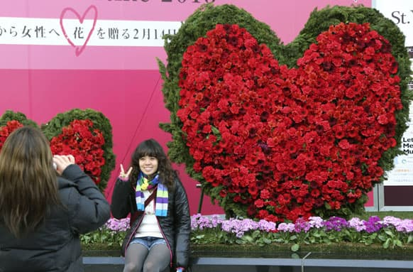 People take a picture in front of a Valentine's Day display in Tokyo.