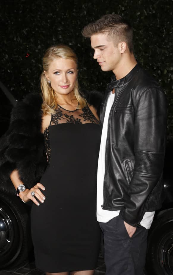 Paris Hilton and River Viiperi attend the Topshop Topman LA Opening Party At Cecconi's in Los Angeles.