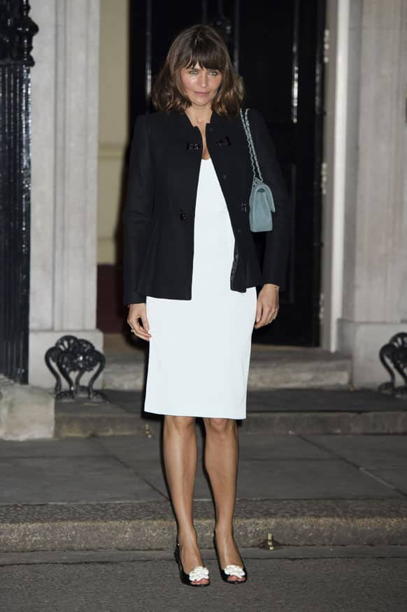 Danish model Helena Christensen arrives for the London Fashion Week reception party at 10 Downing Street, London.