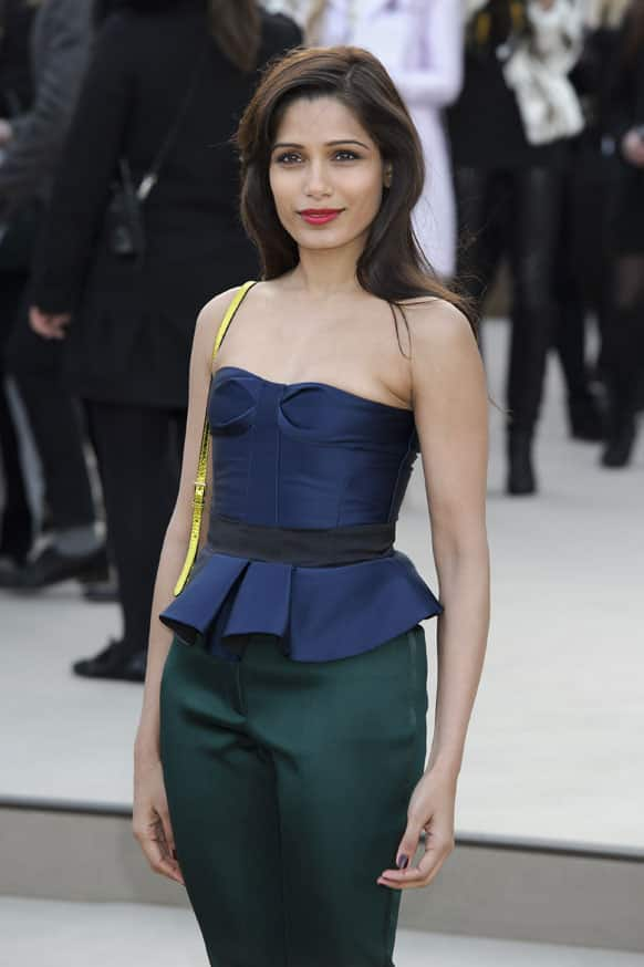 Actress Freida Pinto arrives for the Burberry Prorsum fashion collection during London Fashion Week, at a central London Venue, London.