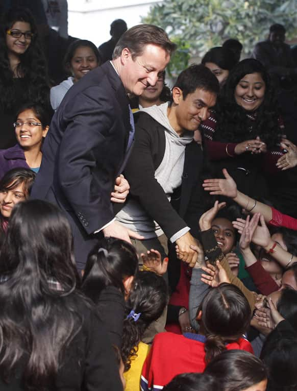 British Prime Minister David Cameron, center left, and Bollywood actor & UNICEF ambassador to promote child nutrition Aamir Khan, center right, meet students at the Janaki Devi Memorial College in New Delhi.