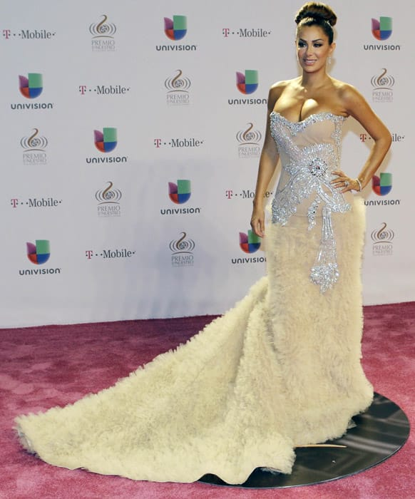 Mexican singer and actress Ninel Conde poses for photographers on the red carpet at the Premio Lo Nuestro Latin Music Awards in Miami.