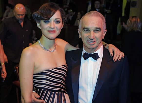 French actress Marion Cotillard poses with President of