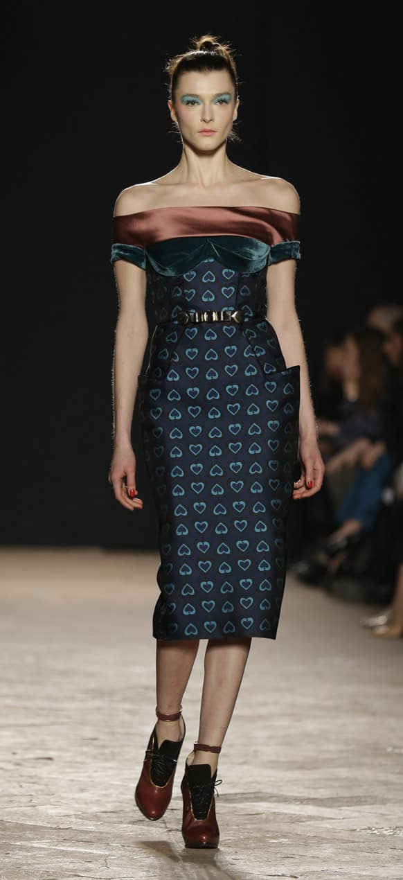 A model wears a creation for Aquilano Rimondi women's Fall-Winter 2013-14 collection, part of the Milan Fashion Week.