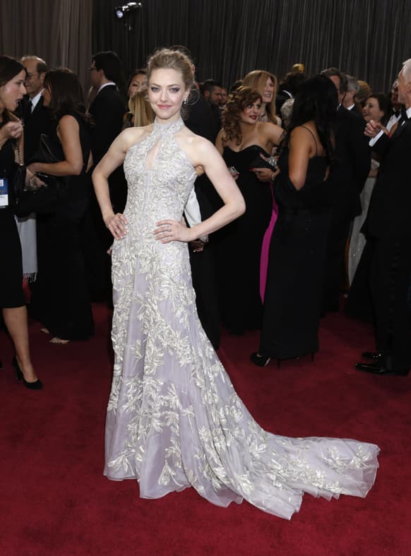 Actress Amanda Seyfried arrives at the Oscars at the Dolby Theatre in Los Angeles.