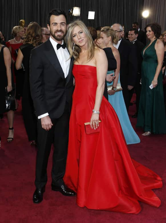 Actors Justin Theroux, left, and Jennifer Aniston arrive at the Oscars at the Dolby Theatre.