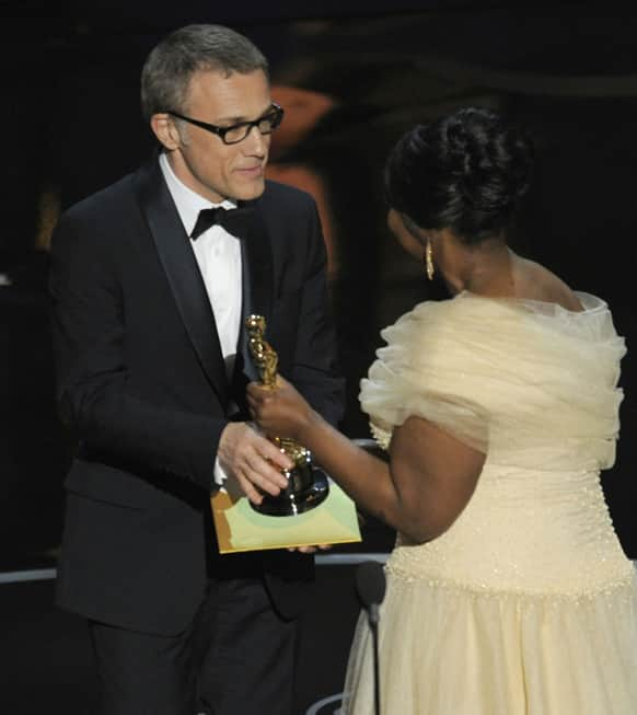 Actress Octavia Spencer, right, presents the award for best actor in a supporting role for