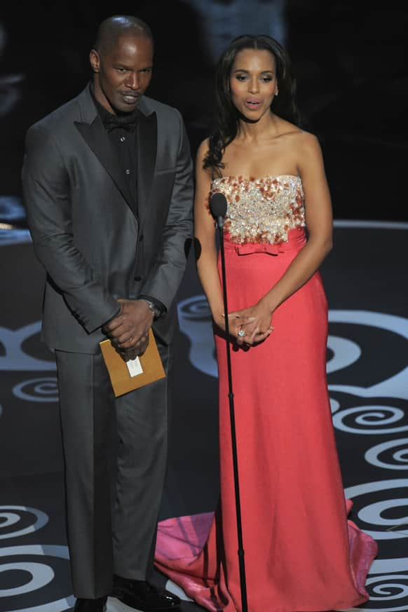 Actors Jamie Foxx, left, and Kerry Washington present an award during the Oscars at the Dolby Theatre.