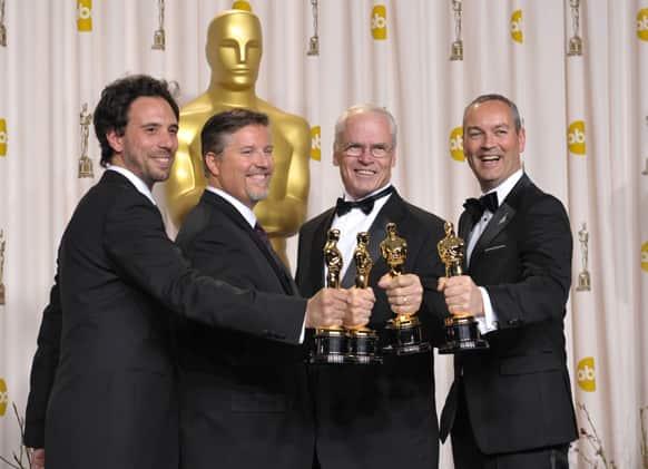 Guillaume Rocheron, from left, Bill Westenhofer, Donald R. Elliott, and Erik-Jan De Boer pose with their award for best visual effects for