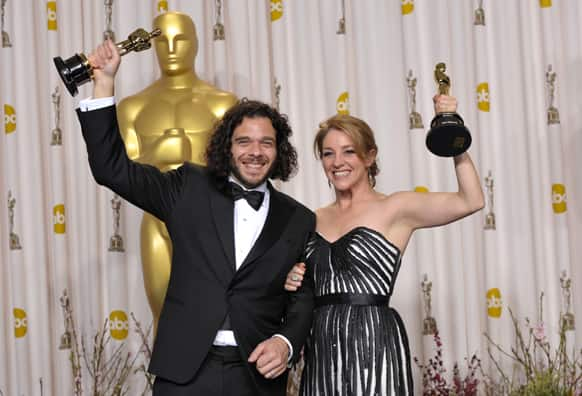 Sean Fine, left, and Andrea Nix Fine pose with their award for best documentary short subject for