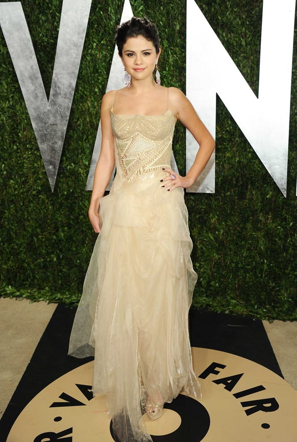 Actress Selena Gomez arrives at the 2013 Vanity Fair Oscar Party, at the Sunset Plaza Hotel in West Hollywood, Calif.