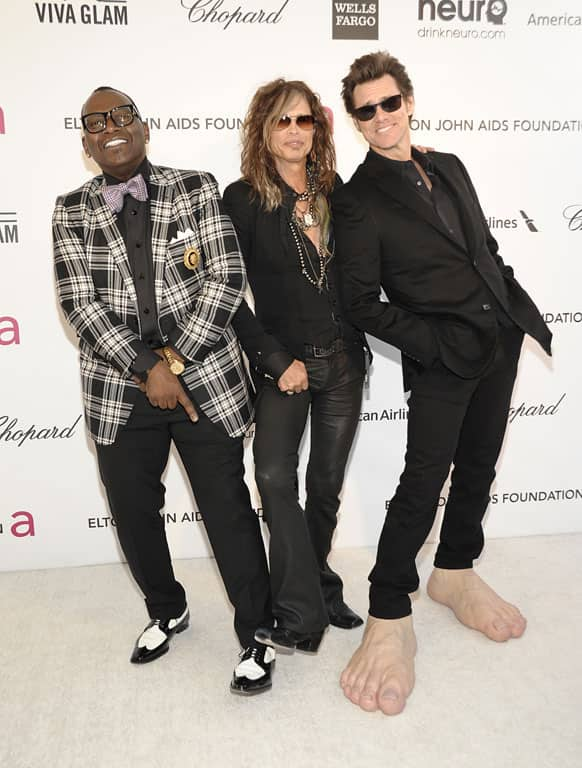 Television personality Randy Jackson, left, singer Steven Tyler, center, and actor Jim Carrey arrive at the 2013 Elton John Oscar Party in West Hollywood, Calif.