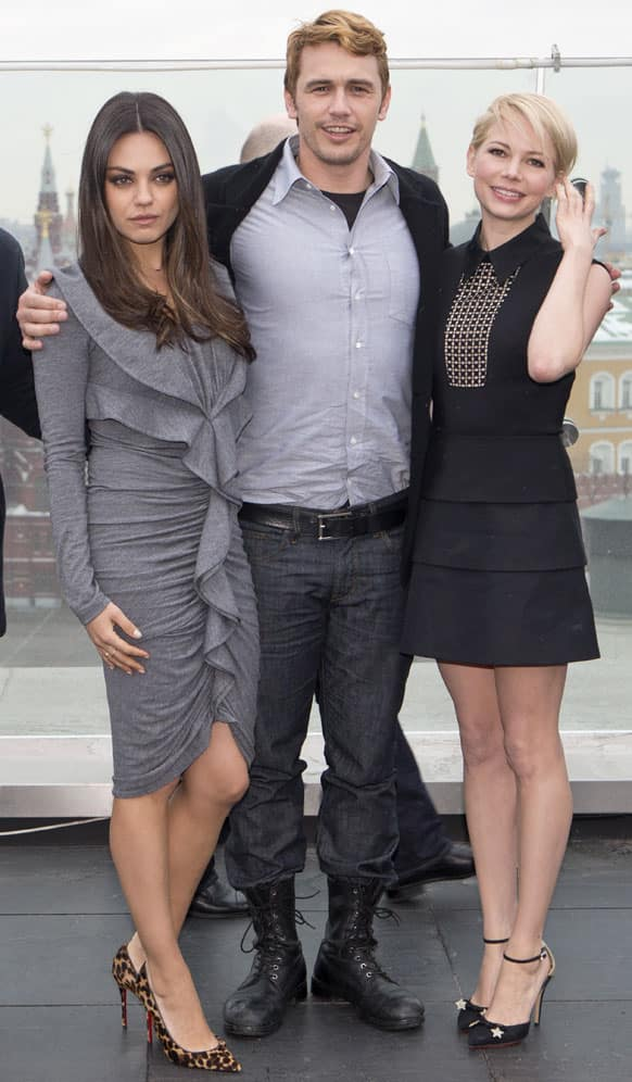 Actors Mila Cunis, left, James Franco and Michelle Williams pose for photographers at a hotel during a photocall for the film