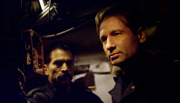 This film image released by RCR Media Group shows David Duchovny, right, and Johnathon Schaech in a scene from