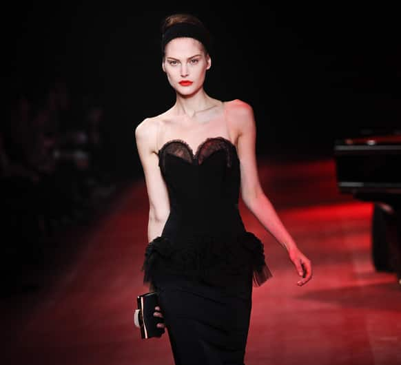 A model presents a creation by fashion designer Peter Copping as part of the Nina Ricci Ready to Wear's Fall-Winter 2013-2014 fashion collection, presented, in Paris.