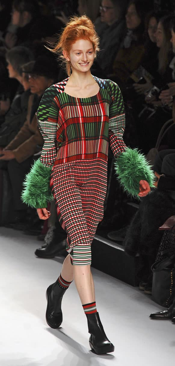 A model wears a creation by fashion house Issey Miyake during the presentation of its Fall/Winter 2013-2014 ready to wear collection in Paris.