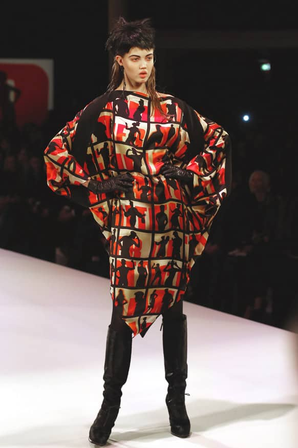 A model wears a creation by French fashion designer Jean-Paul Gaultier as part of his Ready to Wear Fall-Winter 2013-2014 fashion collection, presented in Paris.