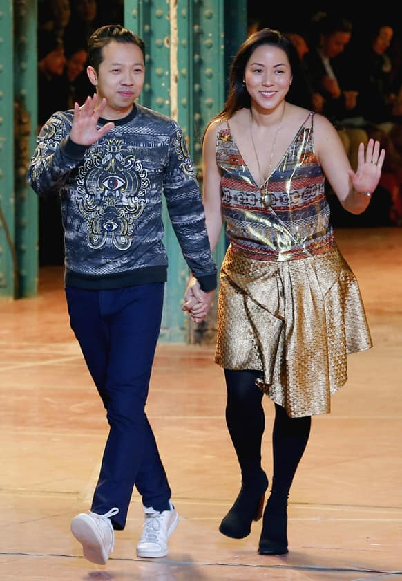 Fashion designers Humberto Leon, left, from Peru, and Carol Lim, from South Korea for Kenzo Ready to Wear Fall-Winter 2013-2014 fashion collection, presented, in Paris.