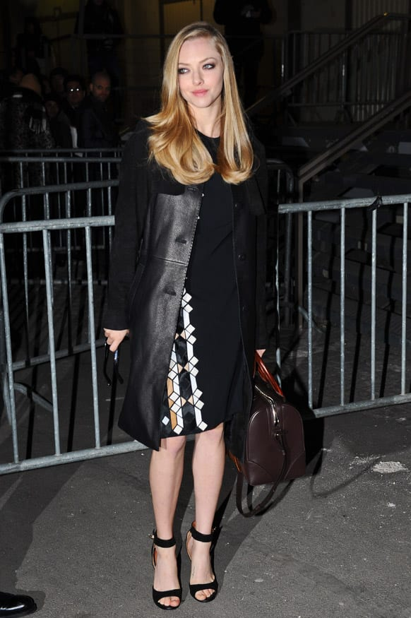 Actress Amanda Seyfried arrives at Givenchy's Ready to Wear's Fall-Winter 2013-2014 fashion collection.