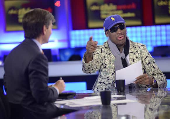Host George Stephanopoulos, left, interviews former NBA star Dennis Rodman, just back from a visit with North Korea's young leader Kim Jong Un, in studio in New York.