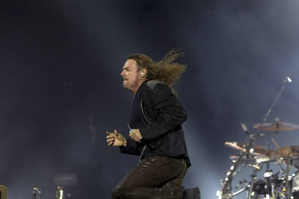 Lead singer Fher Olvera, of the Mexican rock band Mana, performs in concert in Guatemala City.