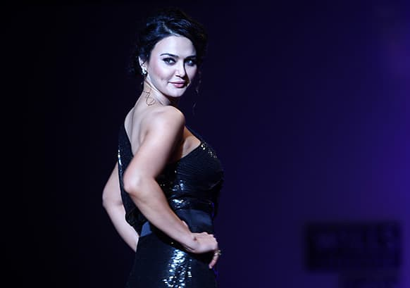 Bollywood actor Preity Zinta displays a creation by Surily Goel during the Wills Lifestyle India Fashion Week in New Delhi.