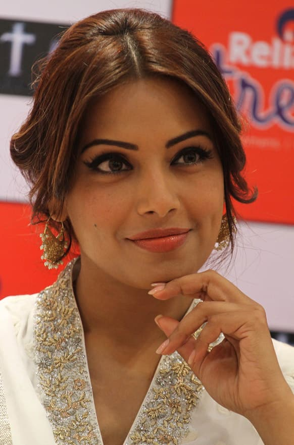 Bipasha Basu smiles during a press conference to promote her upcoming movie