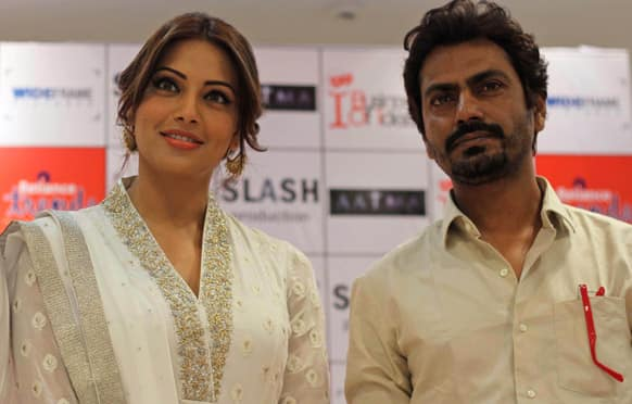 Bipasha Basu and Nawazuddin Siddiqui pose for photographs during a press conference to promote their upcoming movie