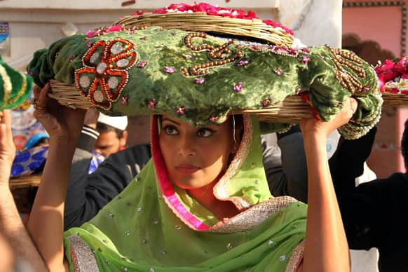 Bollywood actor Bipasha Basu carries offerings of velvet cloth and flowers at the shrine of Sufi saint Khwaja Moinuddin Chishti in Ajmer.