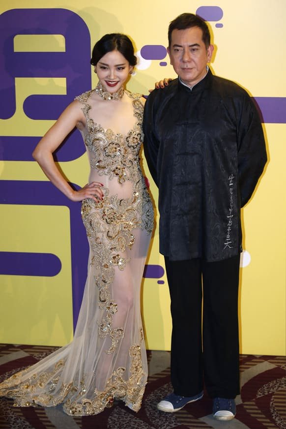 Chinese actress Zhou Chu Chu, left, and Hong Kong actor Anthony Wong pose for the photographers at the red carpet of 37th Hong Kong International Film Festival (HKIFF) Grand Opening in Hong Kong.