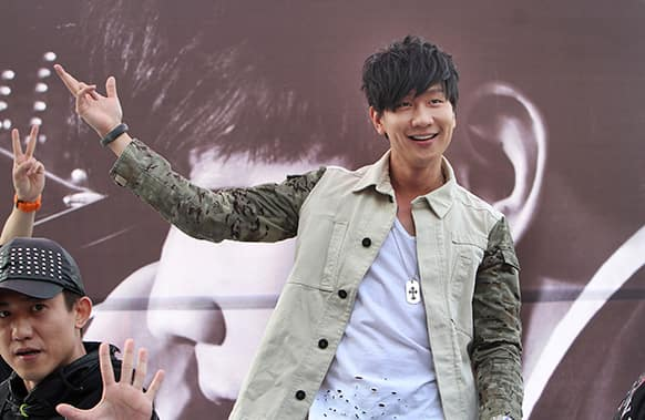 Singapore pop singer JJ Lin poses for photographers during an event to promote his new album