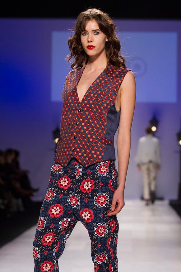 A model wears a creation from Bustle while walking the runway during Toronto Fashion Week.