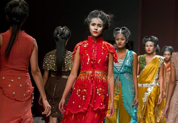 Models display creations by designer Nida Mahmood during the Wills Lifestyle India Fashion Week.