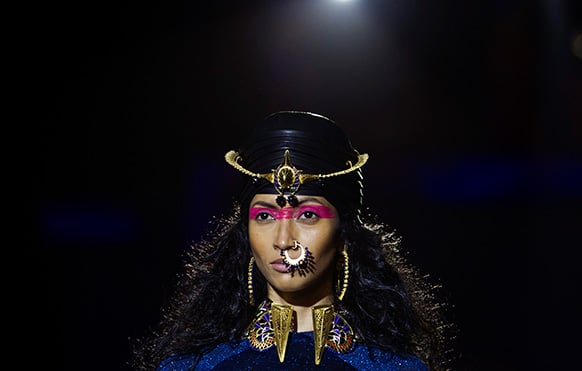 A model displays a creation by designer Manish Arora during the Wills Lifestyle India Fashion Week.