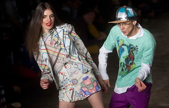 Models dance as they present creations from the Cavalera summer collection during the Sao Paulo Fashion Week.