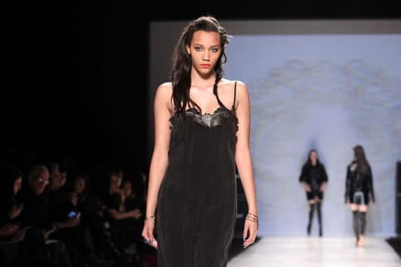 A model wears a creation from Chloe comme Parris while walking the runway during Toronto Fashion Week in Toronto.