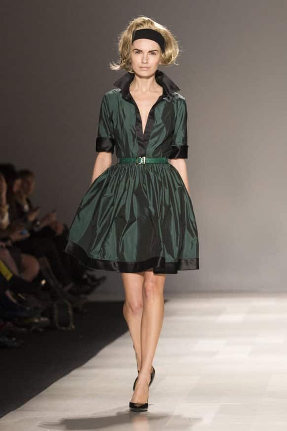 A model shows a creation from Pink Tartan while walking the runway during Toronto Fashion Week in Toronto.