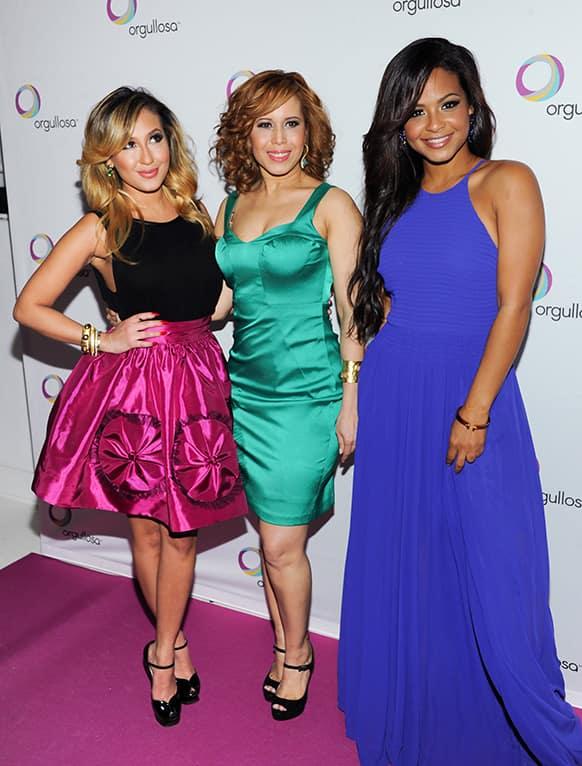 Singer Christina Milian, left, designer Cenia Paredes and singer Adrienne Bailon attend the P&G Orgullosa