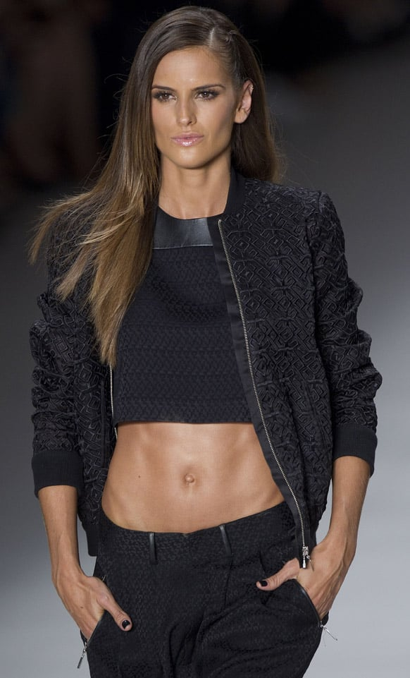 Brazilian model Izabel Goulart wears a creation from the Colcci summer collection at Sao Paulo Fashion Week in Sao Paulo, Brazil.
