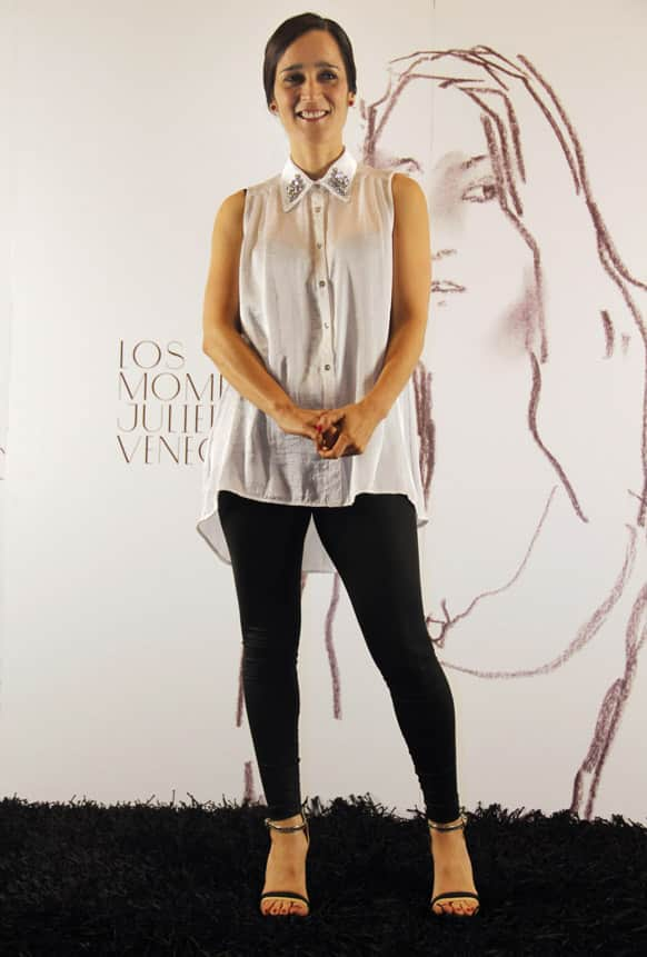 Julieta Venegas poses for photographers at an event promoting her latest album in Mexico City.