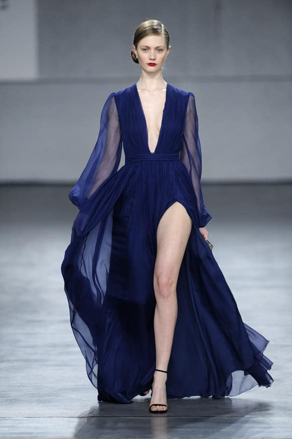 A model displays a creation by Portuguese designer Diogo Miranda during the Portugal Fashion Fall/Winter 2013/14 week.
