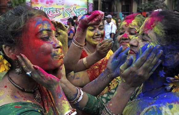 Students smear each other's faces with colored powder as they celebrate Holi, the Hindu festival of colors, at Rabindra Bharati University campus in Kolkata.