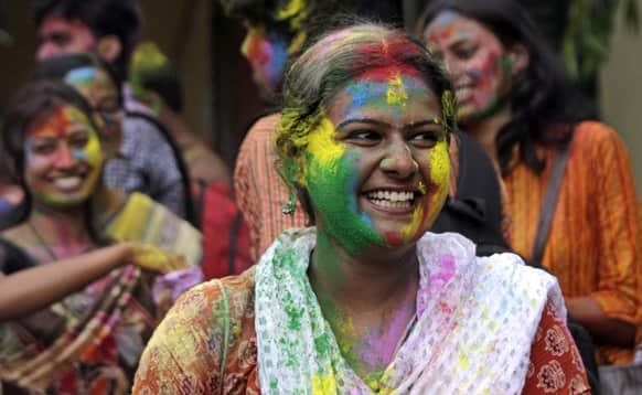 Student, face smeared with colored powder, celebrates Holi, the Hindu festival of colors, at Rabindra Bharati University campus in Kolkata.