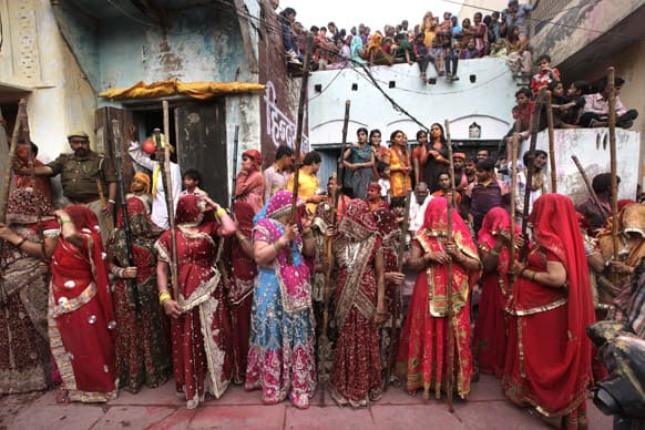 Women from Nandgaon wait for the villagers from Barsana village during Lathmar Holi festival, in Nandgaon.