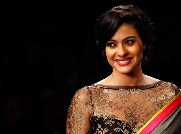 Bollywood Actress Kajol showcases a creation by Manish Malhotra during the first day of Lakme fashion week.